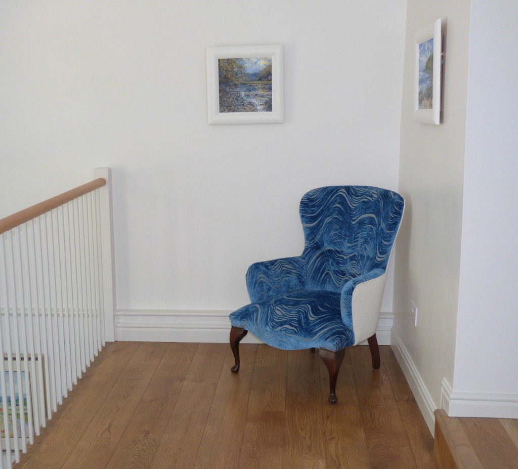 Victorian chair upholstered in Designers Guild Aurelia fabric on a landing with white walls and oak floor